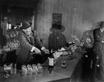 Burt Lancaster smashing booze bar in Elmer Gantry, 1959