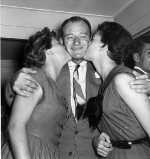 John Wayne with his daughters Melinda (14) and Antonia (18, with bow on dress).