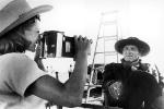 Rita Hayworth photographing Burt Lancaster on the set of The Unforgiving, 1960